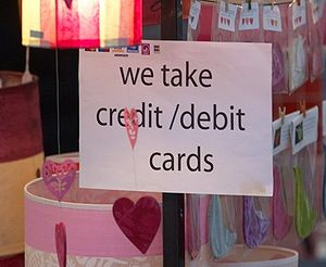 Credit card - An example of street markets accepting credit cards. Most simply display the acceptance marks (stylized logos, shown in the upper-left corner of the sign) of all the cards they accept.