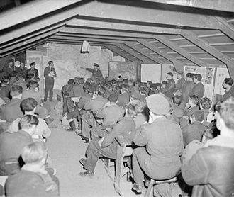 No. 40 Squadron RAF - Wellington aircrew of 40 Squadron are briefed at Foggia Main, Italy, before a bombing raid on railway yards at Sarajevo, Yugoslavia