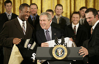 Paul Konerko - Konerko (right) and Jermaine Dye (left) present a jersey to then-President George W. Bush as the White Sox are honored at the White House for their victory in the 2005 World Series.