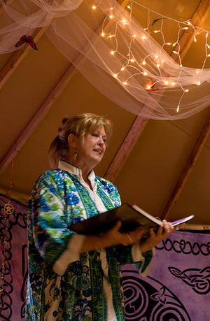 Wiccan priestess preaching in temple.