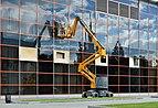 Window cleaner on Haulotte HA15IP lift.jpg