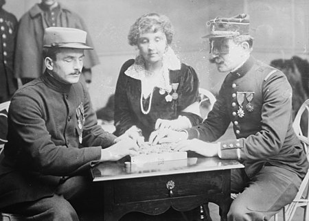 Winifred Holt teaching checkers to blind officers LCCN2014700587 (cropped).jpg