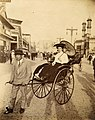 Woman in a rickshaw on the Pike at the 1904 World's Fair.jpg
