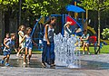 Woman leading children into fountain on Como lakefront.jpg