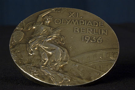 Obverse of John Woodruff's gold medal for winning the 800 metres. WoodRuff 1936 Olympics medal front.jpg