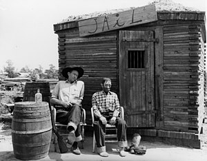 Knott's Berry Farm - Wood carver Andy Anderson with Sad Eye Joe in the Ghost Town area of the park, 1941