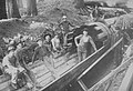 Workers constructing wood stave pipeline, 1900 (51132896579).jpg