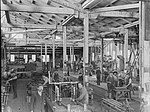 Workmen in locomotive fitting shop (5570146537).jpg