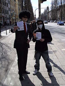 """Anonymous"" members with flyers, at anti-Scientology protests (Munich 2008).jpg"