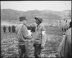 """Pvt. Jonathan Hoag...of a chemical battalion, is awarded the Croix de Guerre by General Alphonse Juin, Commanding Gene - NARA - 531182.tif"