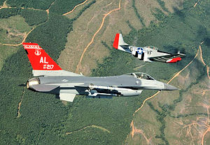 187th Fighter Wing - USAF F-16C Block 30, AF Ser. No. 87-0217 from the 160th FS is seen wearing special tail markings for the Alabama ANG commemorating the reactivation of the 100th FS of the Tuskegee Airmen flies formation with a P-51 Mustang on 12 Sep 2007