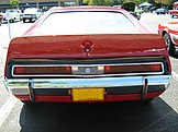Shows the standard duck-tail rear spoiler of the AMX model - finished in red