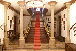 Stair carpet - Staircase with a stair carpet, held with brass stair rods.