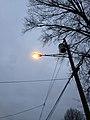 2014-12-20 16 43 12 Sodium vapor lamp on an older support along Meridan Avenue in Ewing, New Jersey.JPG