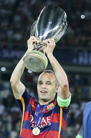 Andrés Iniesta - Iniesta lifting the 2015 UEFA Super Cup trophy.