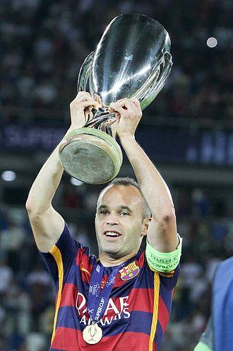 Andrés Iniesta - Iniesta lifting the 2015 UEFA Super Cup trophy.