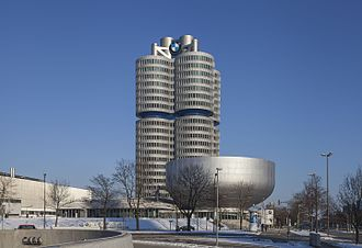 BMW Headquarters building (one of the few buildings that has been built from the top to the bottom) and the bowl shaped BMW museum 4 Cilindros, Munich, Alemania, 2013-02-11, DD 02.JPG