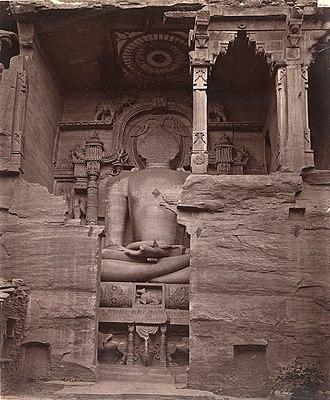 Siddhachal Caves - Image: 7th to 15th century defaced Adinatha Jain tirthankara in Gwalior fort, Siddhachal caves Gopachal 1883