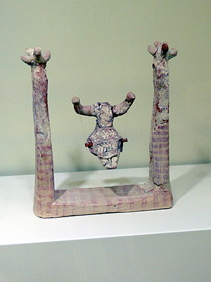 Swing (seat) - Woman sitting on a swing. Hagia Triada, Late New Palace period (1450-1300 B.C.), Heraklion Archaeological Museum, Crete.
