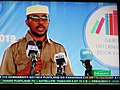 ASC Leiden - van de Bruinhorst Collection - Somaliland 2019 - 4726 - Somali National television. A screen with a bespectacled speaker and microphones addressing the public at another book fair, July 2019.jpg
