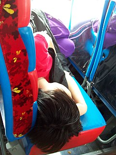 A girl sleep in running bus