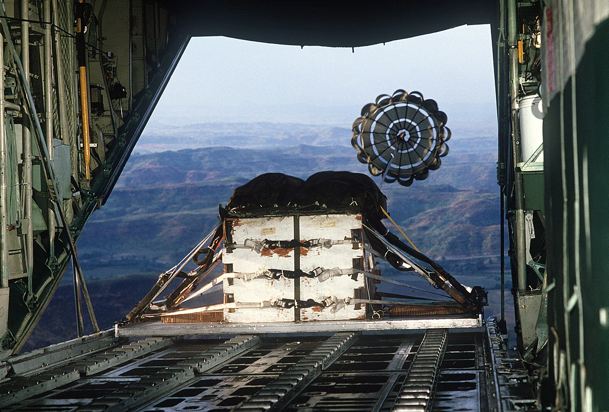 A pallet loaded with heavy cargo is airdropped from a C-130 Hercules aircraft during tactical airdrop training flight for members of the 345th Tactical Airlift Squadron DF-ST-91-10084.jpg