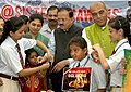 A schoolgirl tying Rakhi to the Minister of State for Defence, Dr. Subhash Ramrao Bhamre, in New Delhi on August 02, 2017.jpg
