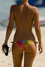 A woman with a suntan wearing a bikini (1).jpg