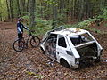 Abandoned Polski Fiat 126p in a forest.jpg
