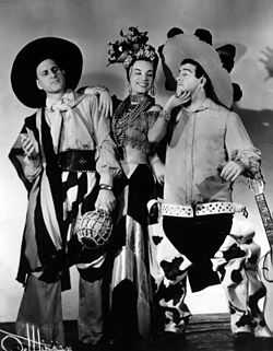 Publicity photo of Abbott and Costello, dressed as Latin musicians, with Miranda