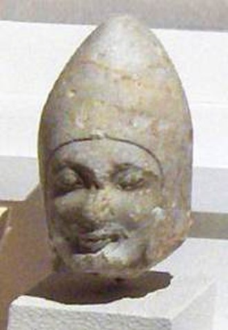 Portrait - Portrait of an Achaemenid Satrap of Asia Minor (the Herakleia head, from Heraclea, in Bithynia), end of 6th century BCE. This is an Eastern portrait in purely East Greek Archaic style, one of the two known forerunners of extant Greek portraits, with the Sabouroff head.