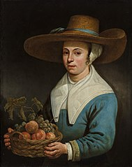 Girl with a straw hat, with a basket of grapes