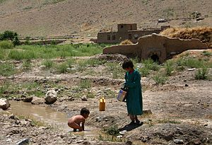Children at a creek, Afghanistan