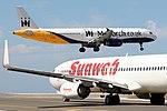 "Airbus A321-231 Monarch G-OZBL over the Boeing 737-8K2 Transavia ""Sunweb"" sticks PH-HZX.jpg"