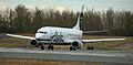 Alaska Air 737 Combi turning onto the active runway at ANC (6193708437).jpg