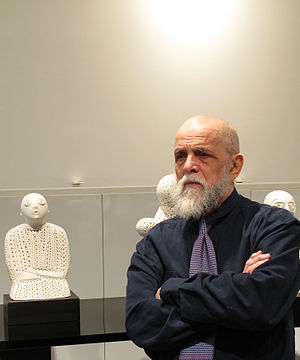 "Alexander Ney - Alexander Ney in 2008, pictured with his sculpture ""Singing Girl""."