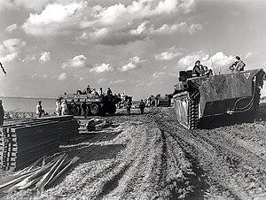 Battle of the Scheldt - Column of  Alligator amphibious vehicles passing Terrapin amphibious vehicles on the Scheldt river, October 1944.