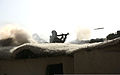 An Afghan National Army commando with the 3rd Company, 3rd Special Operations Kandak fires a rocket-propelled grenade launcher from the roof of a compound toward an identified enemy fighting position during 140101-A-LW390-268.jpg