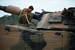 An Australian soldier assigned to the 2nd Cavalry Regimentinspects an M1 Abrams tank during exercise Talisman Saber 2017.jpg