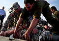 An Israeli Defense Forces medic, right, cares for a U.S. Soldier role-playing as a victim during an emergency response exercise as part of Austere Challenge 2012 in Beit Ezra, Israel 121022-F-QW942-066.jpg