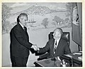 An unidentified man shakes hands with Mayor John F. Collins (12306273154).jpg