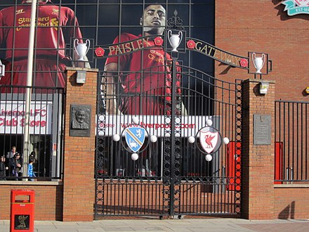 The Paisley Gateway was erected at one of the entrances to Anfield. It includes a depiction of the record three European Cups he won during his tenure as manager, the crest of his birthplace in Hetton-le-Hole, and the crest of Liverpool F.C. Anfield Stadium - IMG 2164.JPG