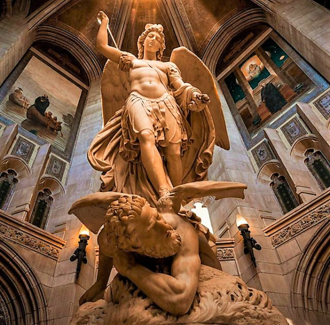 Sculpture of archangel Michael conquering Lucifer. Archangel Michael Boston College.png