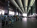 Arrivals area of BLR Airport, July 2013.jpg