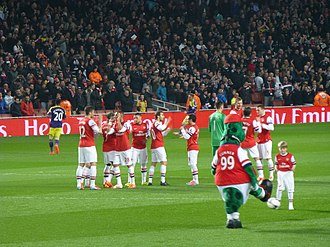 2013–14 Arsenal F.C. season - Arsenal players before their match against Swansea City on 25 March. Prior to that game, Arsenal had a record of 6 wins, 5 losses and 1 draw against the Welsh club.