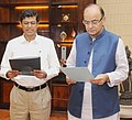 Arun Jaitley administering the oath to Shri Madhusudan Sahoo as the Chairperson of the Insolvency and Bankruptcy Board of India (IBBI), in New Delhi.jpg