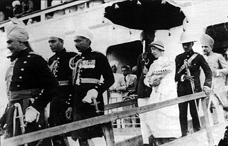 Mukarram Jah - Nanny carrying the prince from board after arrival in Bombay, 1934