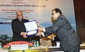 Ashok Gajapathi Raju Pusapati receiving a cheque as final dividend for the year 2014-15 from the Chairman, Airports Authority of India, Shri R.K. Srivastava.jpg