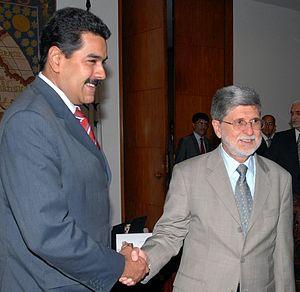 Celso Amorim and Nicolas Maduro.