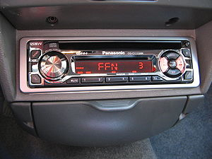 Vehicle audio - A DIN head unit with radio and CD